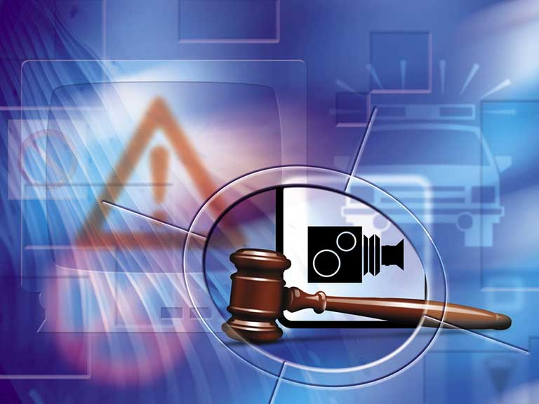 Image depicts a gavel and speed camera to represent a motoring offence