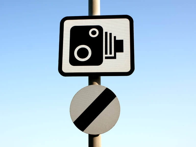 National speed limit sign and speed camera sign