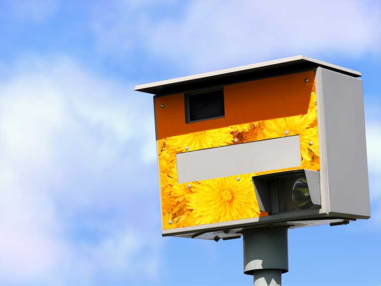 A speed camera waiting to catch someone speeding