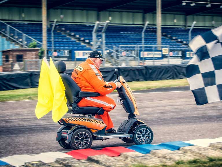Steve Tarrant marshalling at a Formula One event in his TGA Vita 4 mobility scooter