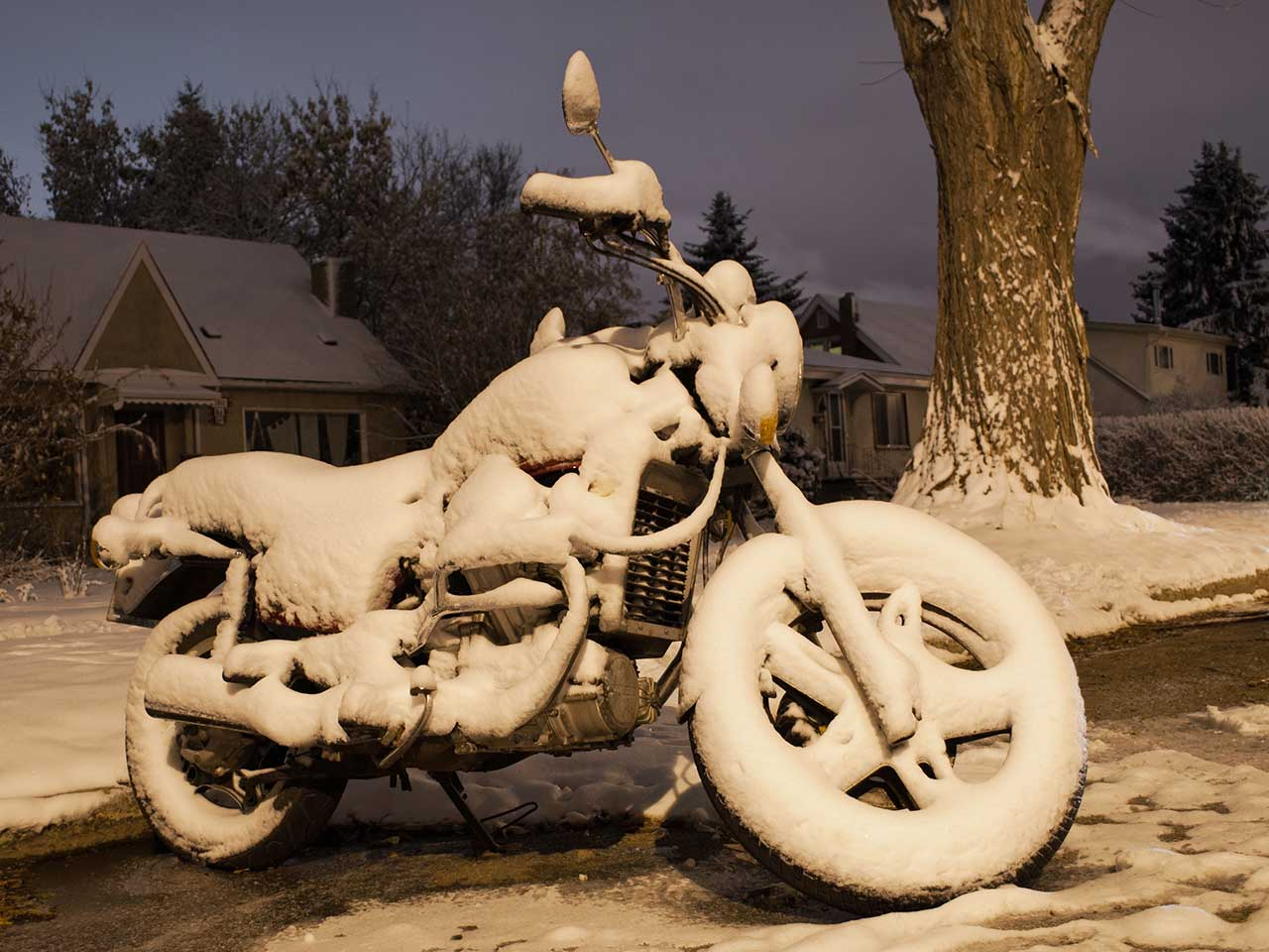 Motorbike covered in snow during the Winter