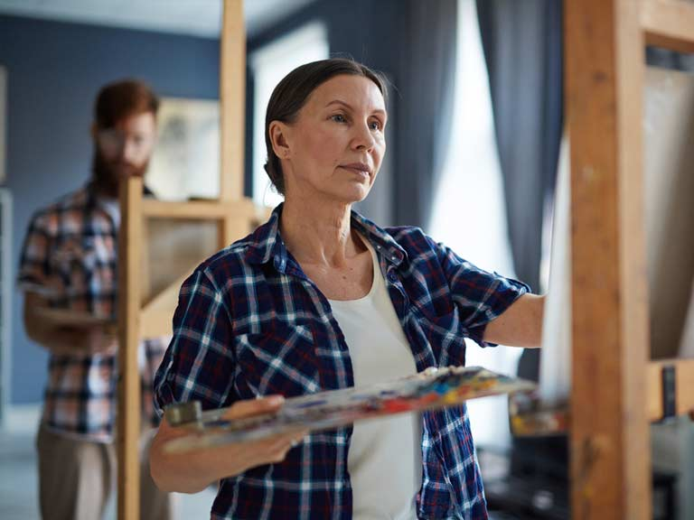A woman taking a painting class to move on after the death of her husband