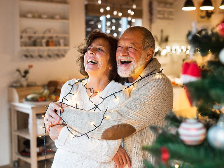 An older couple celebrate their first Christmas together