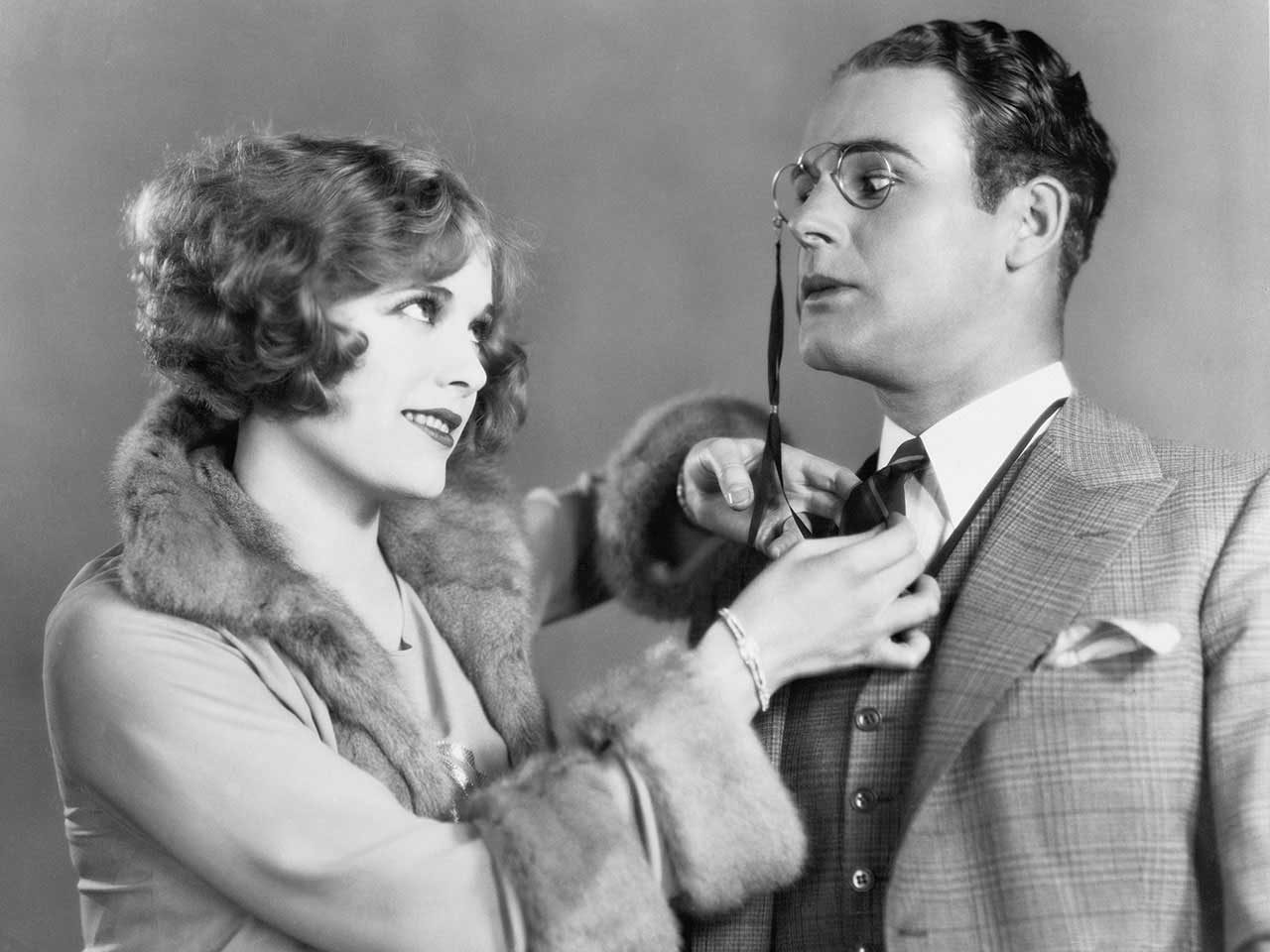 Vintage shot of woman straightening a man's tie