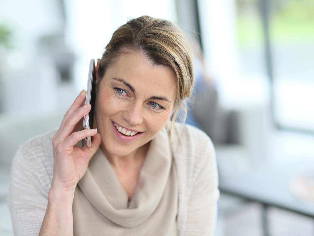 Woman on telephone to partner