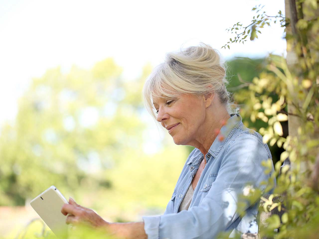 Senior woman using digital tablet