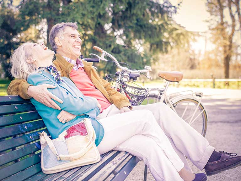 An older couple go for a date in the park