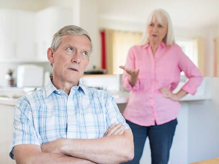 An older couple bicker at home