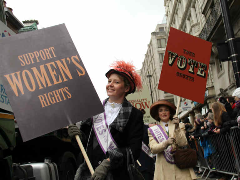 A woman reenacts the suffragette protests | Editorial credit:  / Shutterstock.com