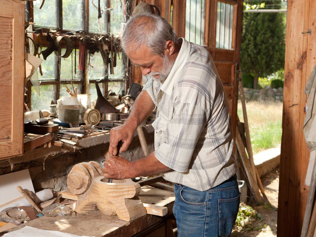 Retired man doing woodwork