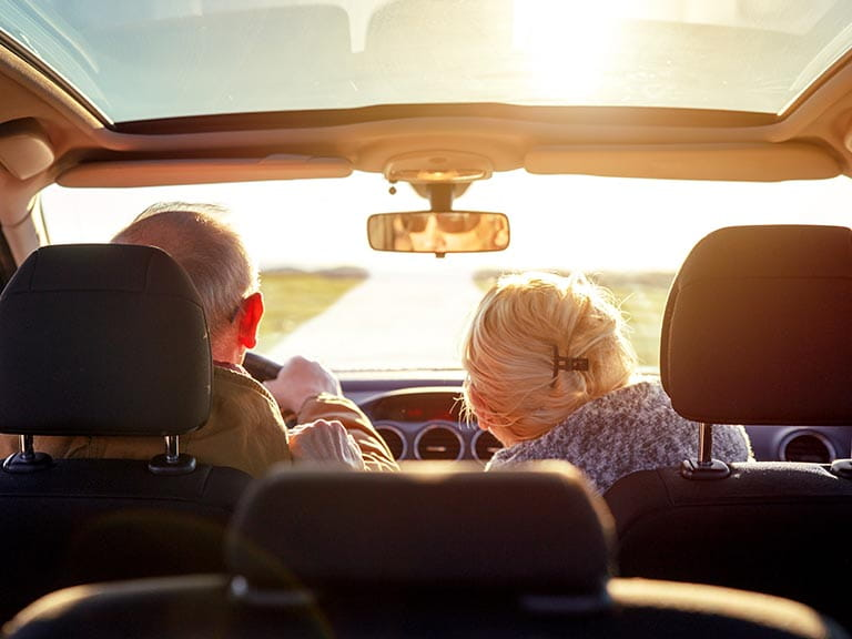 An older couple continue to enjoy driving after a driving assessment