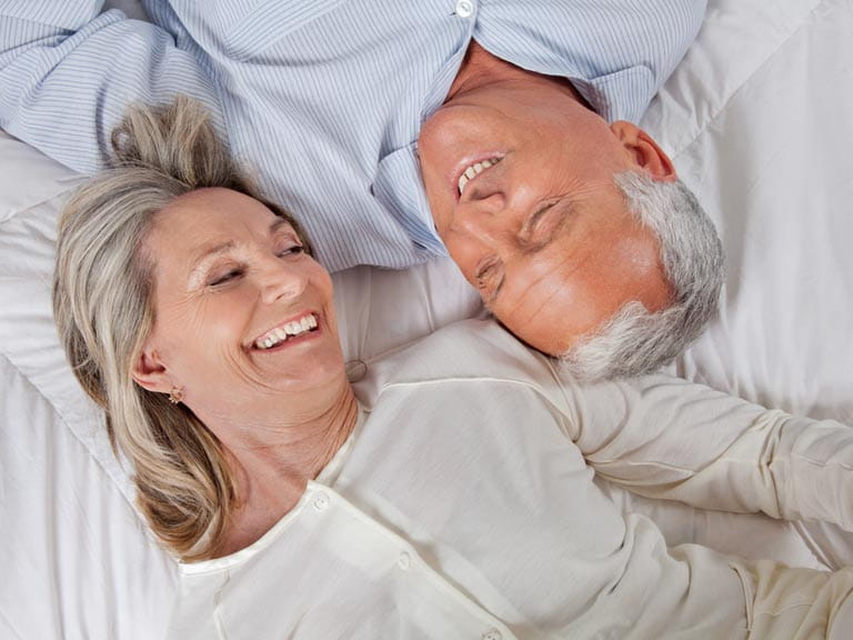 Mature couple in bed