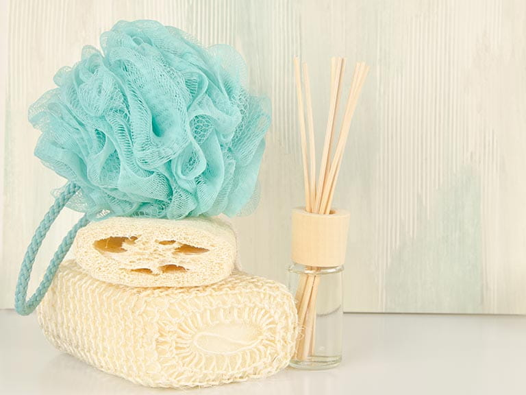 Fake tan application tools, including a scourer and sponge