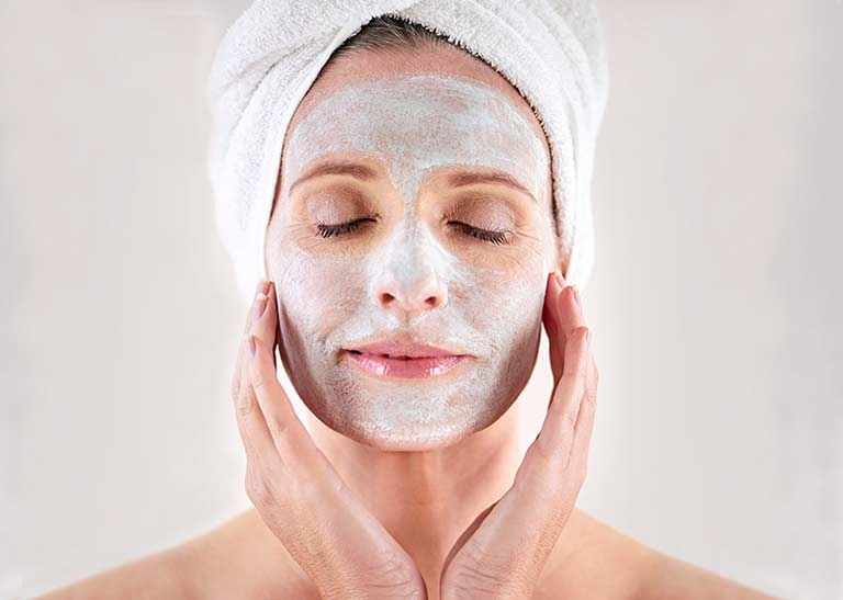 An older lady wears a beauty face mask