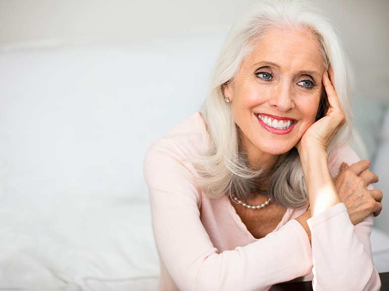 A beautiful older lady with naturally grey hair
