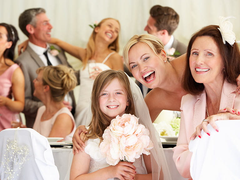 Multi-generational wedding guests posing for photo