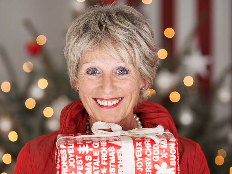 An older woman looks beautiful at Christmas