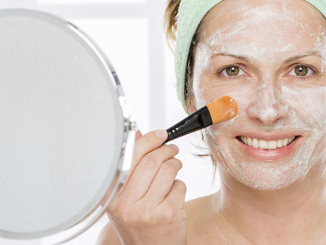 Woman using face mask for younger looking skin