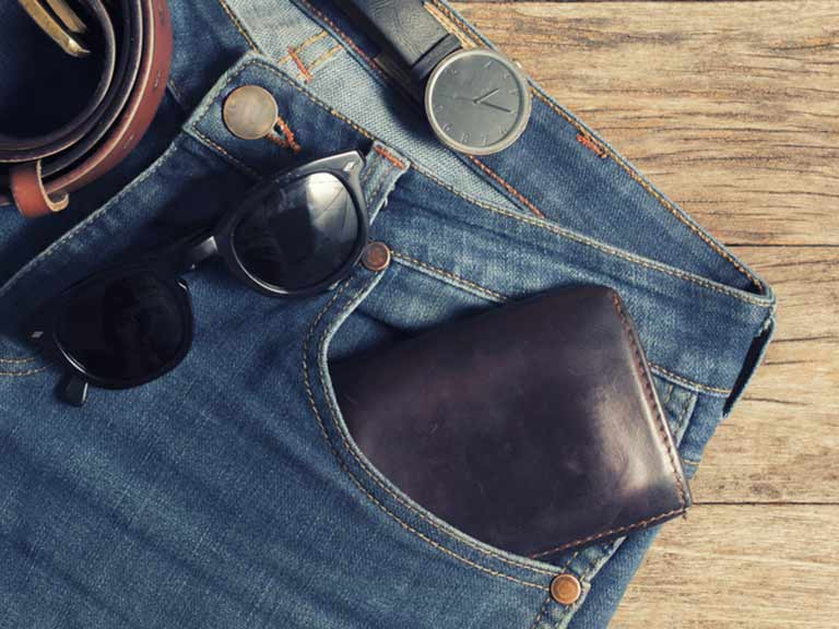 Watch, sunglasses, wallet and belt on jeans - fur of the five essential accessories for any man