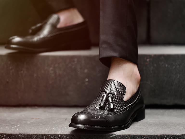 A man wearing black loafers