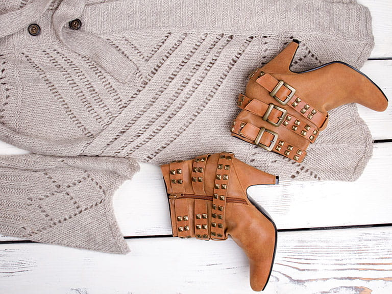 A knitted cardigan and ankle boots