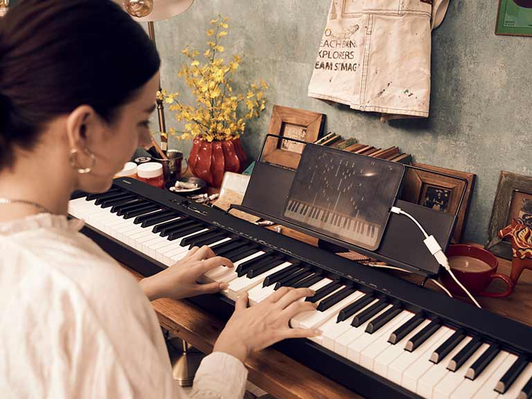 Woman playing Casio piano
