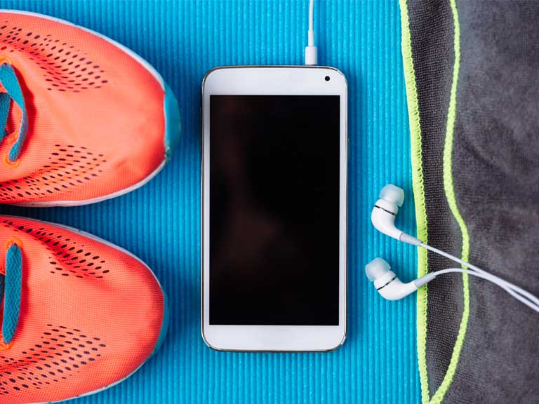 Running shoes and an iPhone to represent fitness and exercise apps