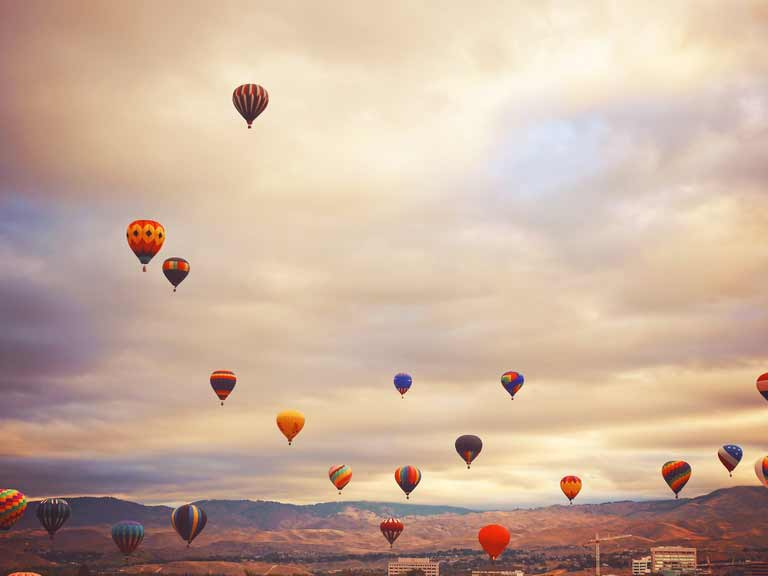 A photo of hot air balloons edited with Instagram