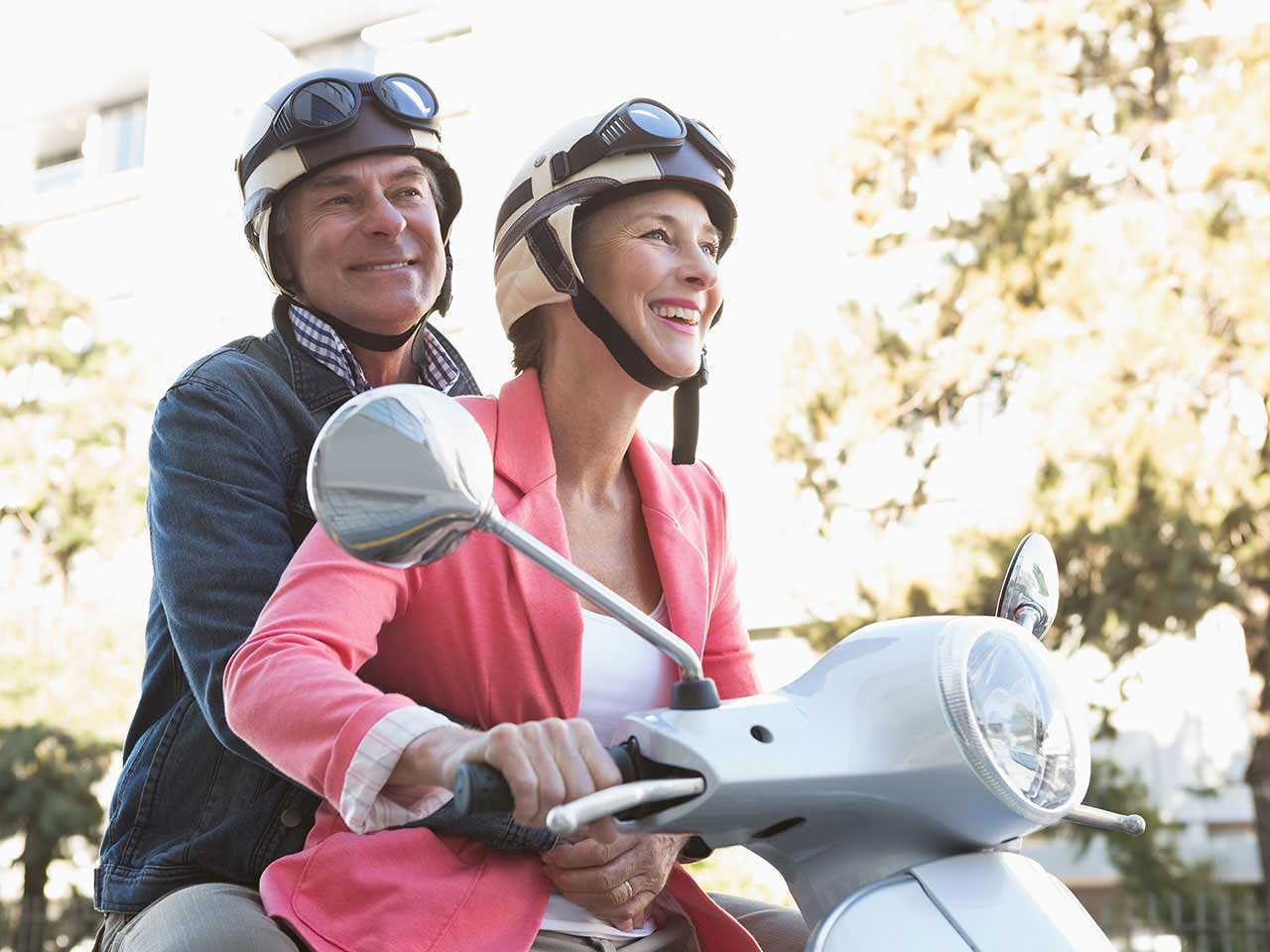 Mature couple on moped