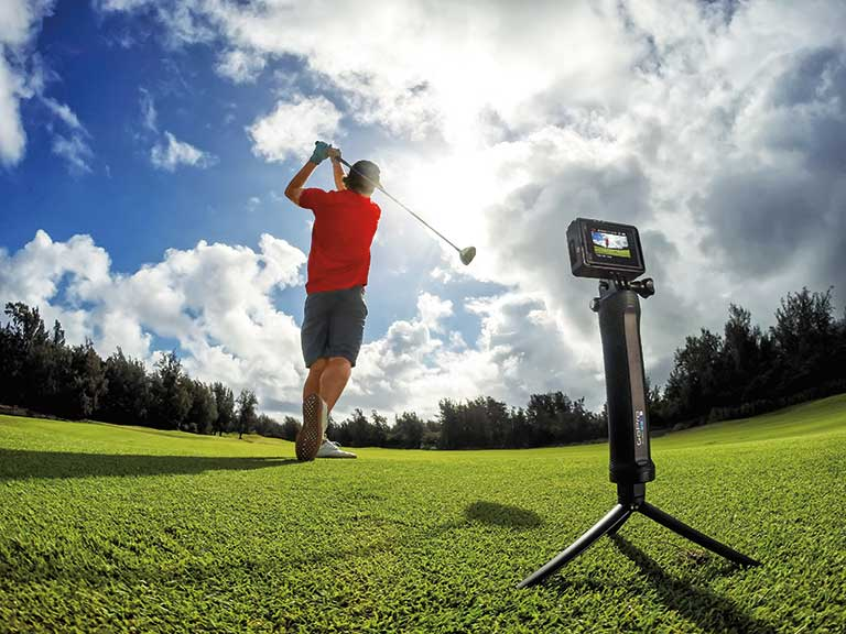 A golfer uses a GoPro to capture the perfect drive