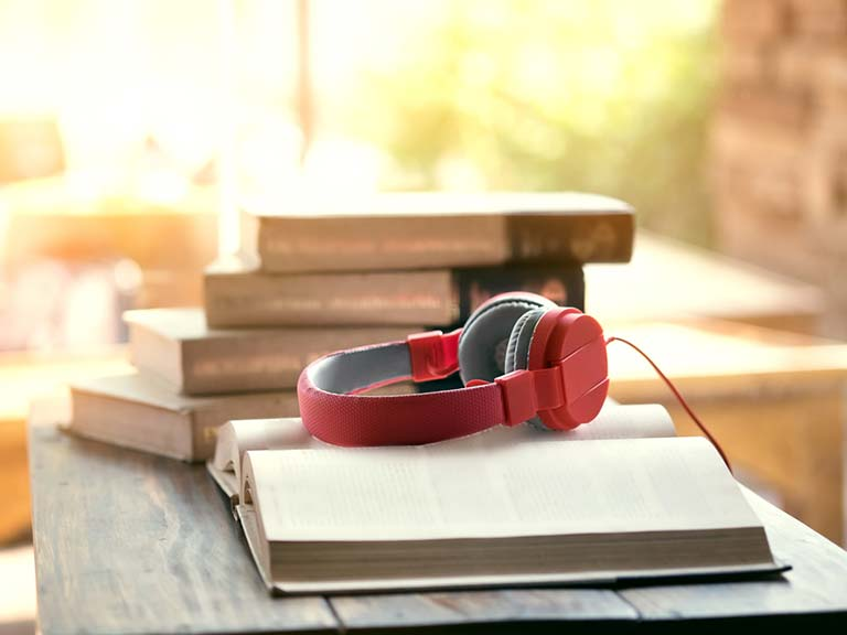 Headphones on an open book