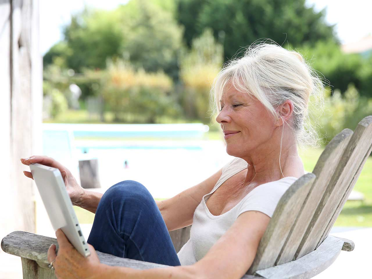 Mature lady using tablet