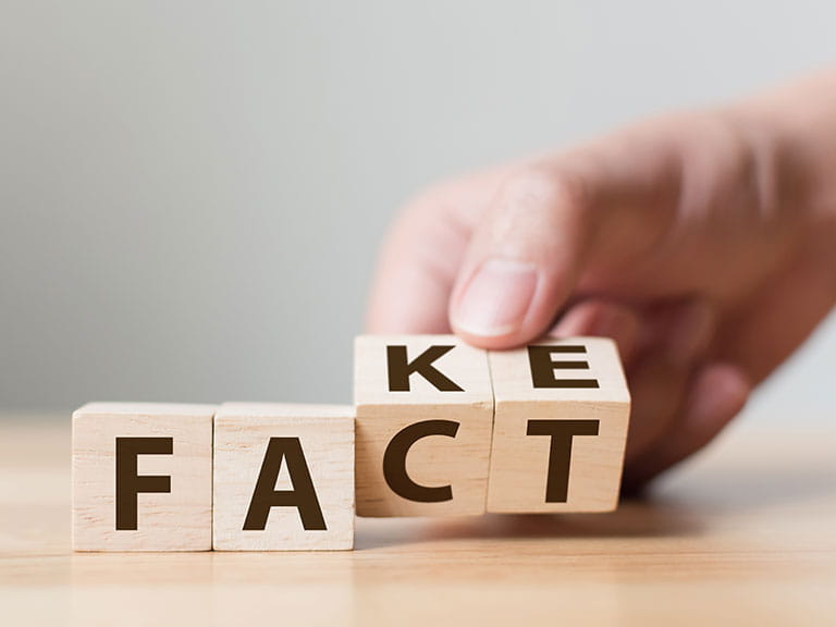 Letter blocks that could say 'fake' or 'fact' depending on how you look at them...
