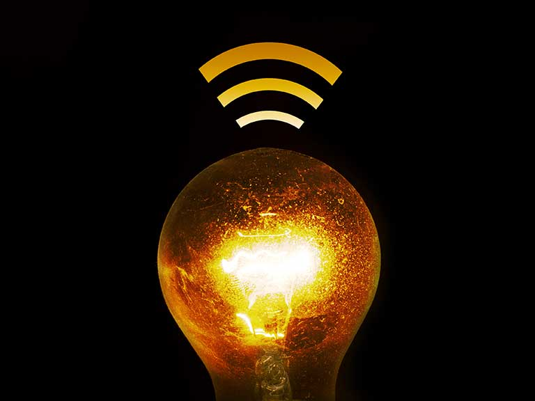 A lightbulb emitting a signal to answer the question: What is Li-Fi?
