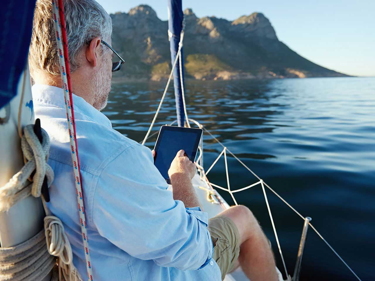 Man at sea using tablet
