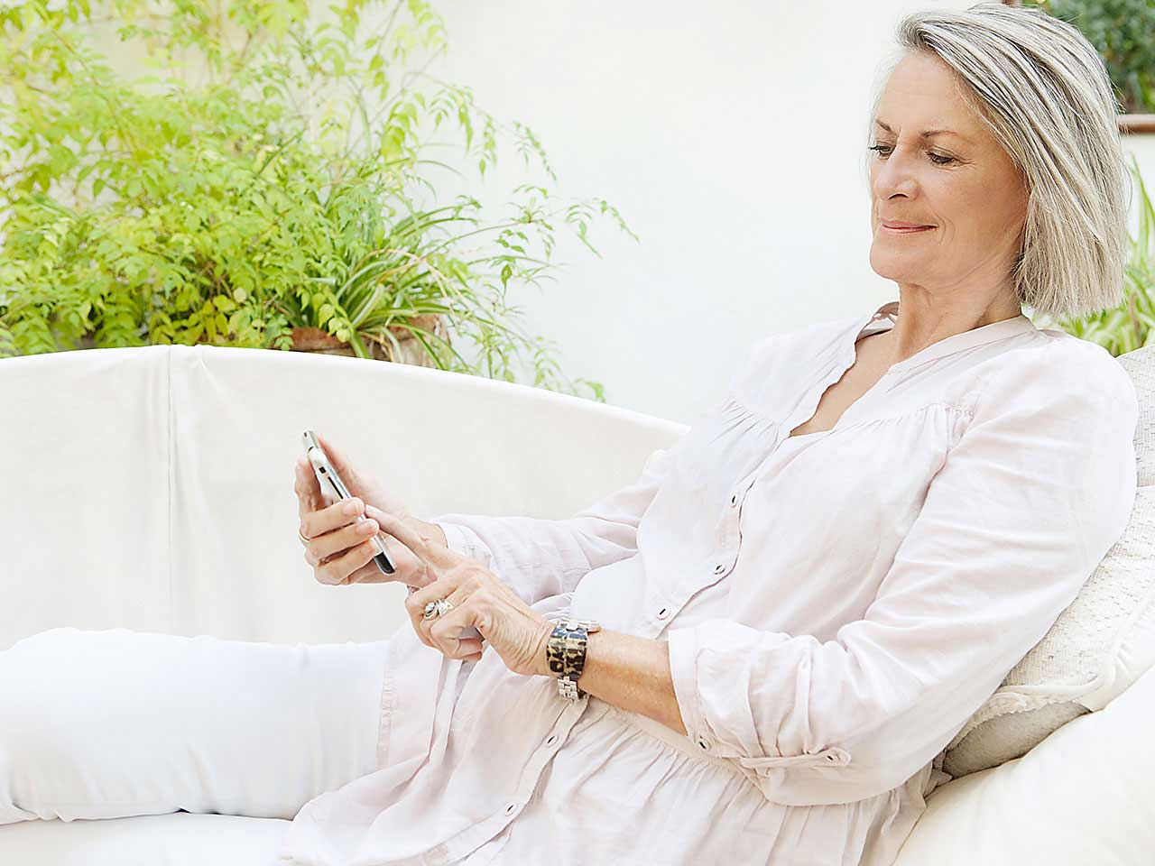 Mature lady using smartphone