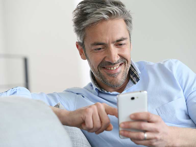 A man uses his smartphone