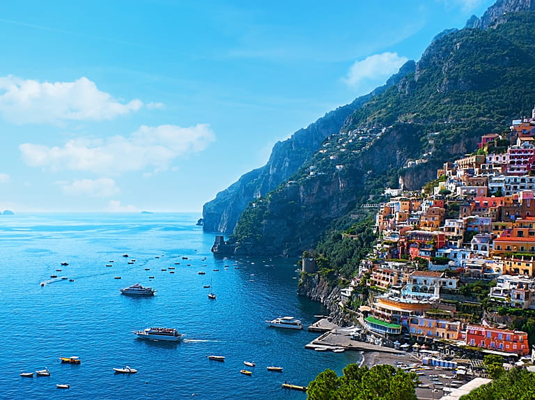The Small Haven Of Positano Village With Tiny Beach And Colorful Houses Located On
