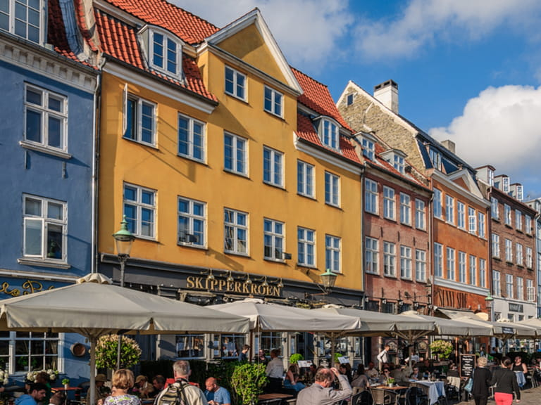 Perspective view to the many restaurants and seafront cafes on Nyhavn district in Copenhagen