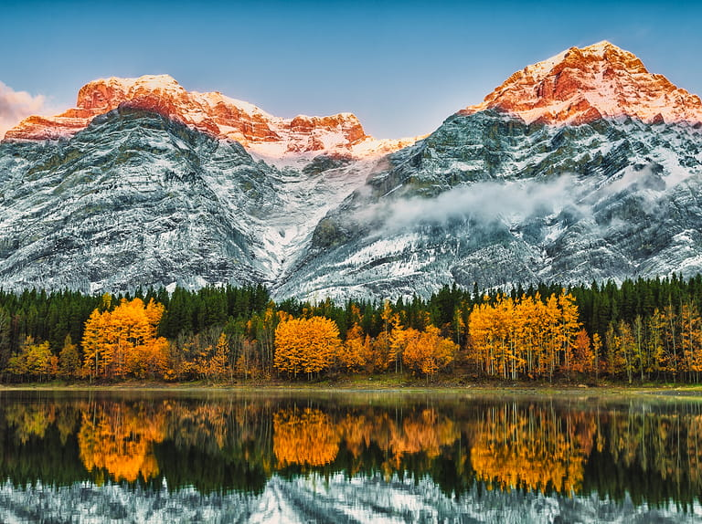 Early morning sun lighting the peaks behind Wedge pond, Kananaskis Alberta