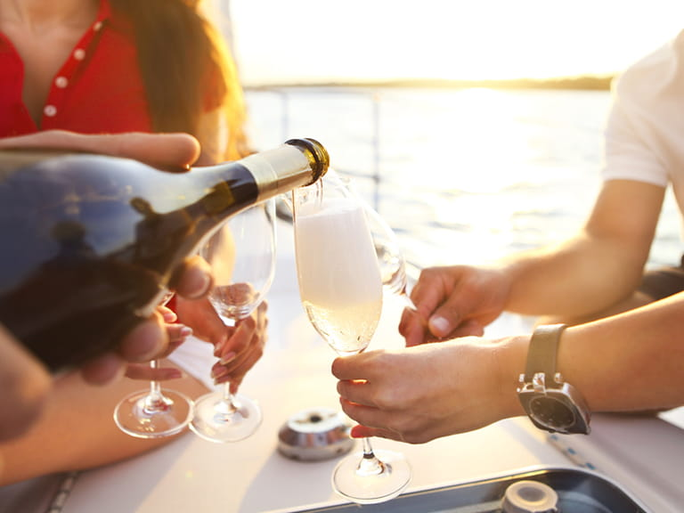 People enjoying Prosecco on a boat