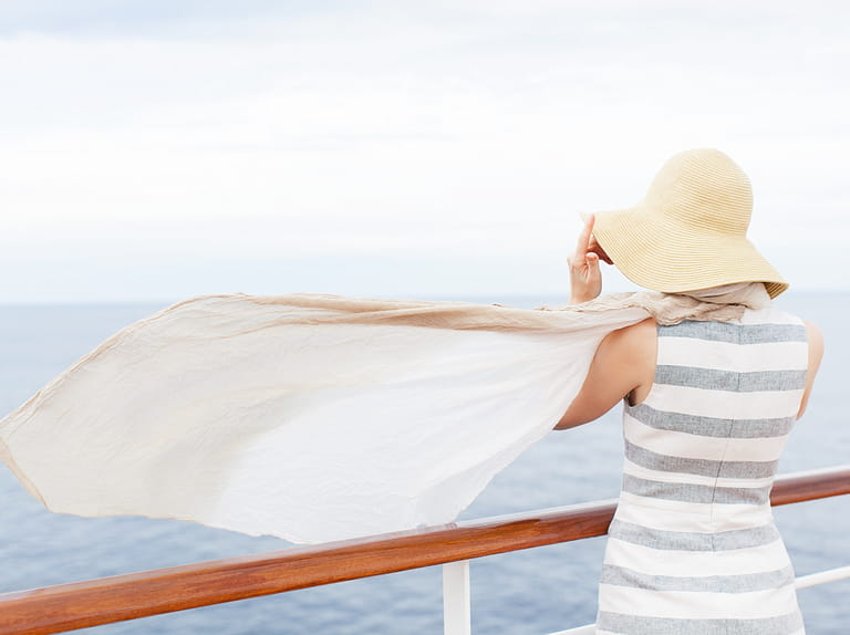 Single lady on deck of cruise ship