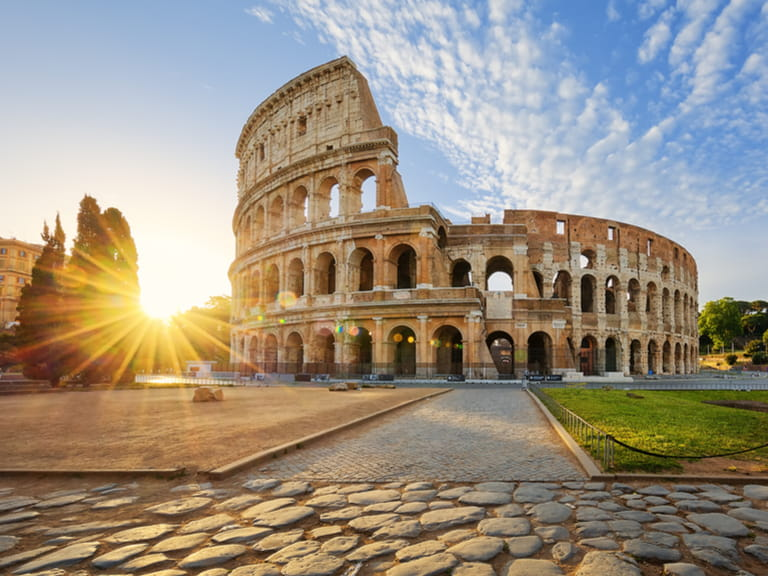 View of Colosseum in Rome and morning sun, Italy,
