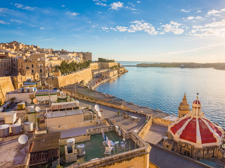 Sunrise at the Grand Harbour of Malta with the ancient walls of Valletta