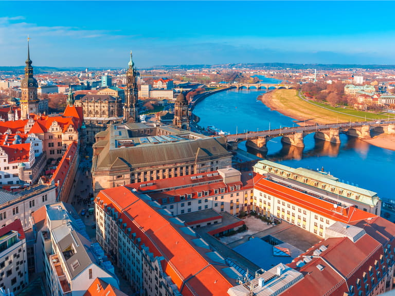The river Elbe with Augustus Bridge, Hofkirche, Royal Palace and roofs of old Dresden, Saxony, Germany, European river cruises