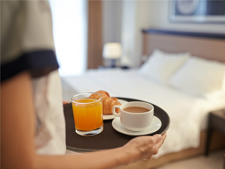 Cabin service tray with tea and orange juice