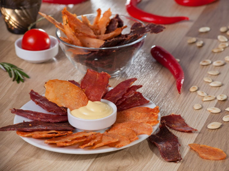 A platter of Biltong and homemade crisps, served with mayonnaise