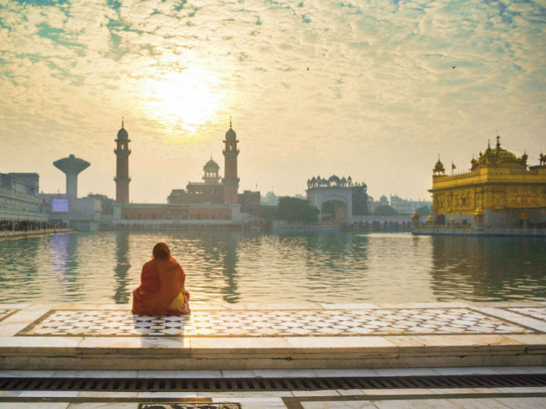 Woman praying at the Golden Temple