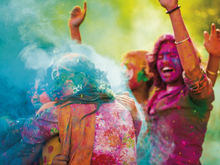 Two people celebrating Holi, the festival of colours