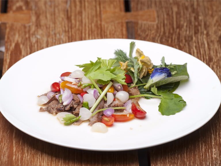 Neua Nam Tok – grilled beef salad is a popular drinking food